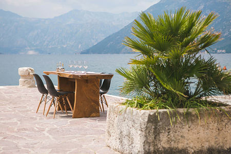 dining on the waterside pontoon at palazzo radomiri hotel montenegro