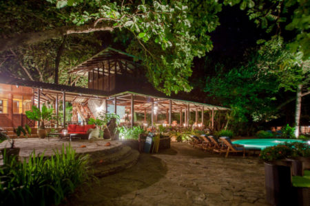dining room and pool at night at latitude 10 costa rica