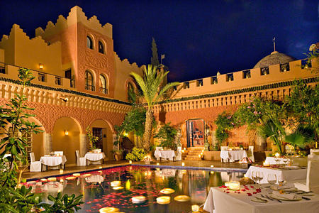 dinner by the pool at kasbah tamadot hotel morocco