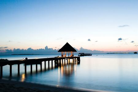 sunset at coco palm dhuni kolhu resort maldives