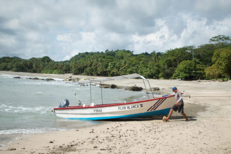 fishing boat on the beach at flor blanca resort costa rica
