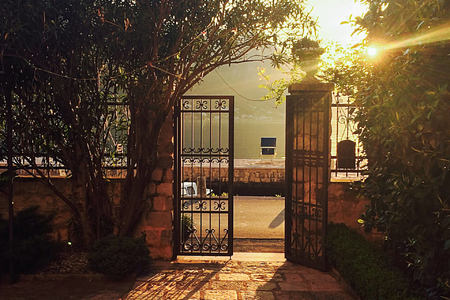 garden gates leading out to boka kotorska bay at palazzo radomiri hotel montenegro