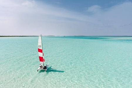 hobie cat sailing at soneva jani beach resort