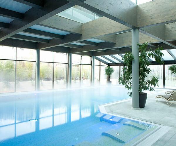 indoor spa pool at parkhotel igls hotel austria