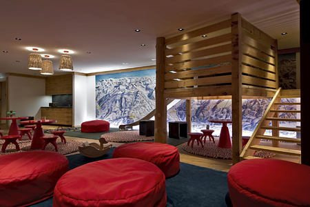 kids entertainment room at alpina gstaad hotel switzerland
