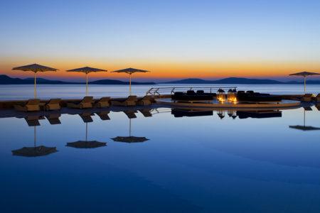main pool at dusk at Mykonos Grand