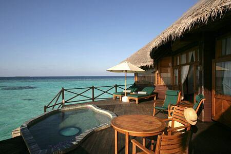 villa pool at coco palm dhuni kolhu resort maldives