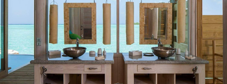 one bedroom overwater villa bedroom at soneva jani beach resort