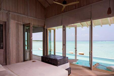 overwater villa bedroom view at soneva jani beach resort