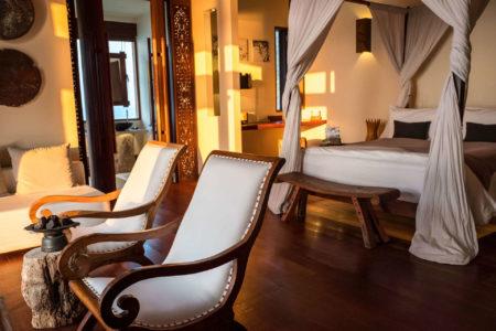 overwater villa bedroom at song saa resort cambodia