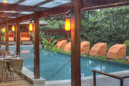 pool and dining terrace at nayara springs hotel costa rica