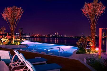 pool at night at The Retreat Palm