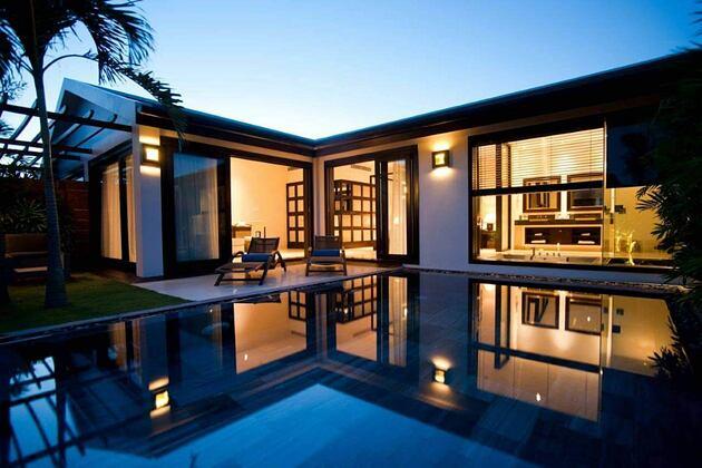 pool villa at night at fusion maia resort vietnam
