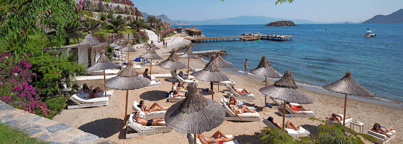 relax on the beach at sianji wellbeing resort turkey