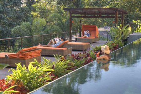 relaxing beside the pool at nayara springs hotel costa rica