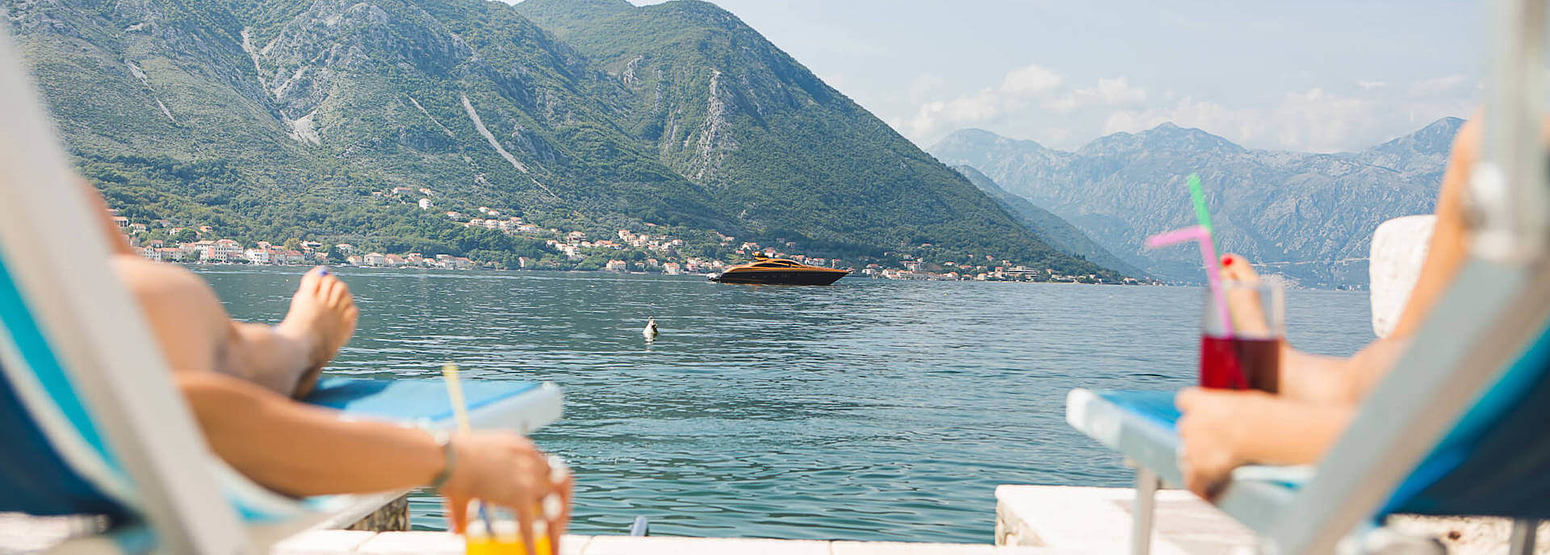 sunbathing on the pontoon at palazzo radomiri hotel montenegro