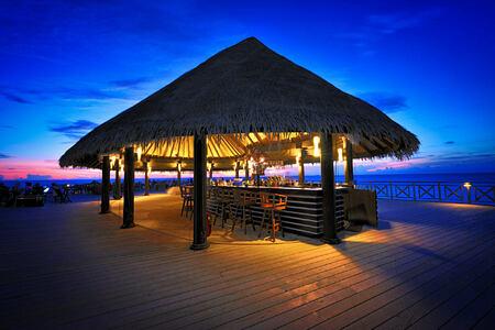 sundowners bar at sunset at Bandos Island Resort Maldives