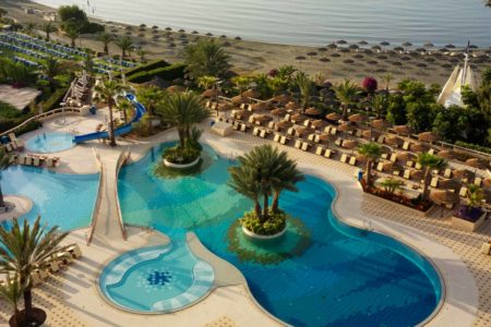 swimming pool and beach at four seasons limasol hotel cyprus