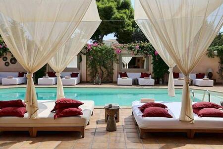swimming pool and cabanas at The Margi hotel