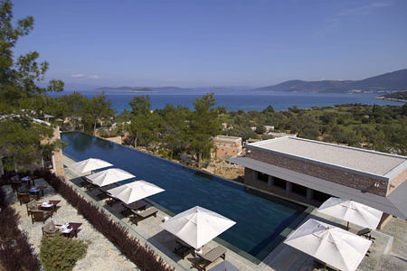 swimming pool and sea view at amanruya hotel turkey