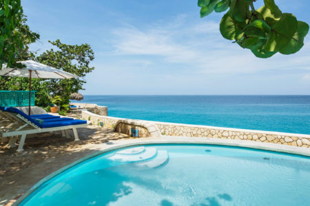 swimming pool and sun loungers at the caves hotel jamaica