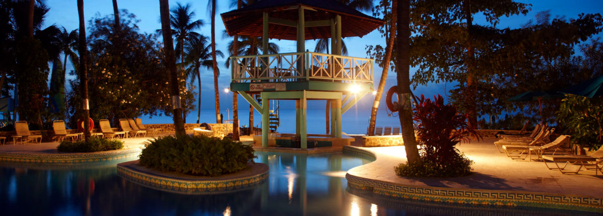 swimming pool at night at rendezvous resort st lucia caribbean