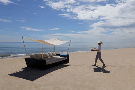 the beach with day bed at fusion maia resort vietnam