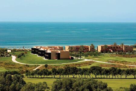 view of accommodation and beach beyond at Verdura Resort Italy