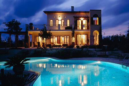 villa and pool at night at aphrodite hills hotel cyrpus