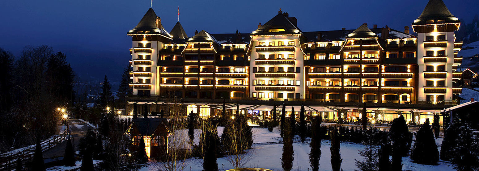 winter exterior view at night at alpina gstaad hotel switzerland