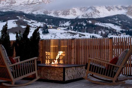 A snowy panorama at dusk view at Hotel La Majun Italy