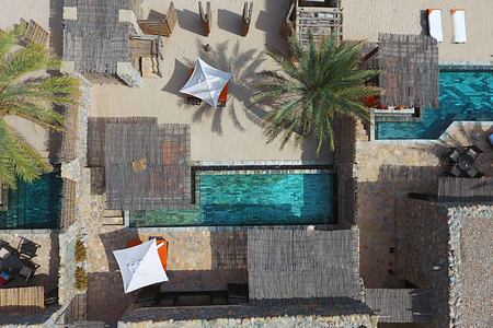 Aerial view of Pool Villa Suite Beach Front at Six Senses Zighy Bay Oman