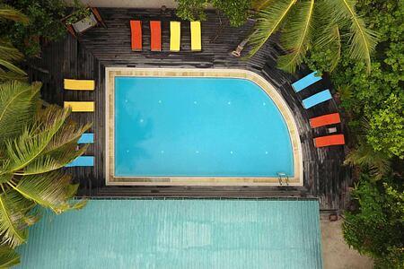 Aerial view of swimming pool at reethi beach resort maldives
