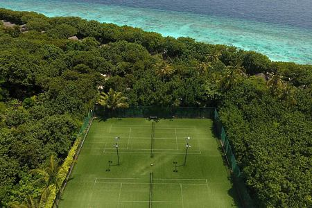 Aerial view of tennis courts at reethi beach resort maldives