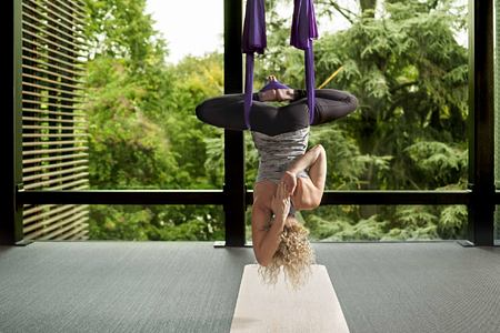 Someone upside down practicing aerial yoga at Six Senses Douro Valley Portugal