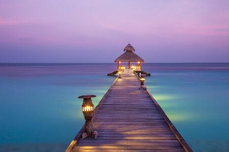 Arrival Jetty at night at reethi beach resort maldives