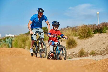 Family enjoying the BMX Pump Track at Martinhal Resort, Portugal