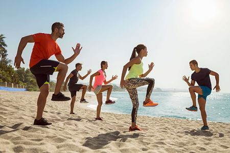Beach exercise at Marbella Beach Club Spain