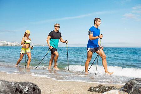 Beach walking at Marbella Beach Club Spain