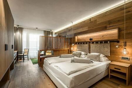 Bedroom at Hotel La Majun Italy