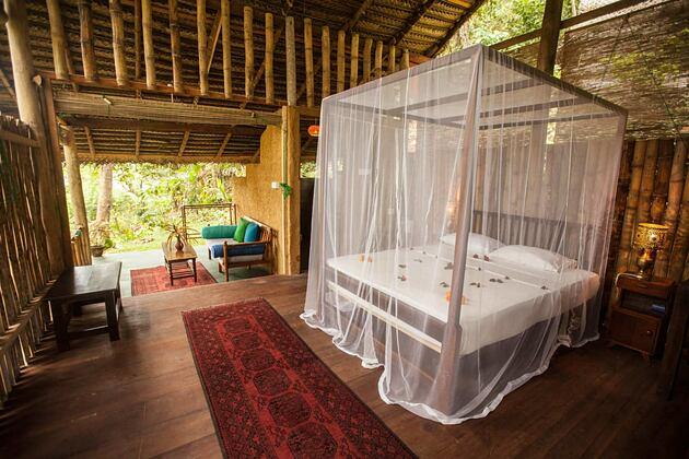 Bedroom in bamboo hut at Talalla Retreat Sri Lanka