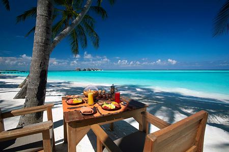 Breakfast by the beach at Main Restaurant at Gili Lankanfushi Maldives