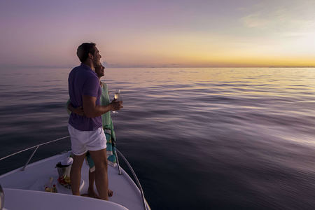 Couple enjoying a Sunset Cruise at Denis Private Island Seychelles