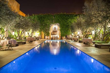Dinner by the pool at Villa des Oranges Morocco