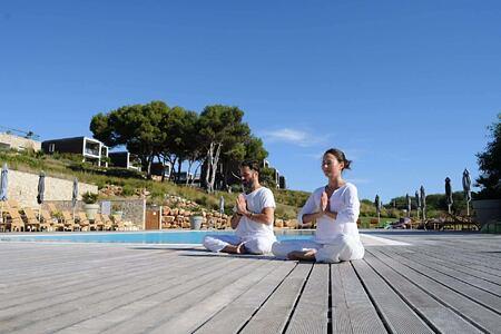 Enjoying Yoga outside at Martinhal Resort, Portugal
