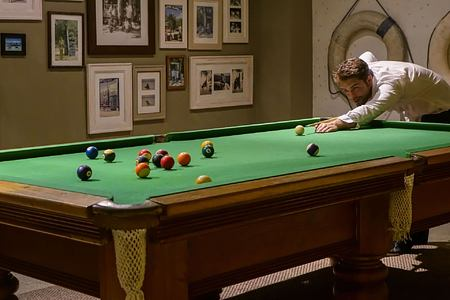 Enjoying a game of Billiards at Denis Private Island Seychelles