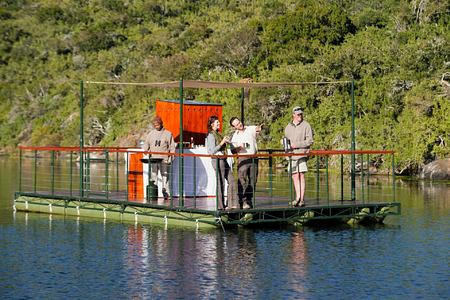 Group enjoying a floating drinks stop on the river at Kwandwe South Africa