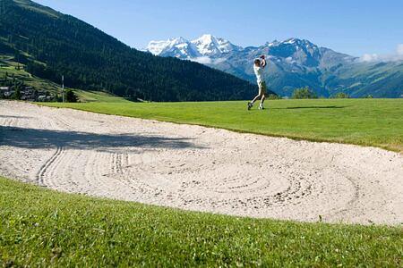 Man playing golf at The Lodge Switzerland