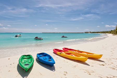 Kayaks on the beach at Hideaway Beach Resort Maldives