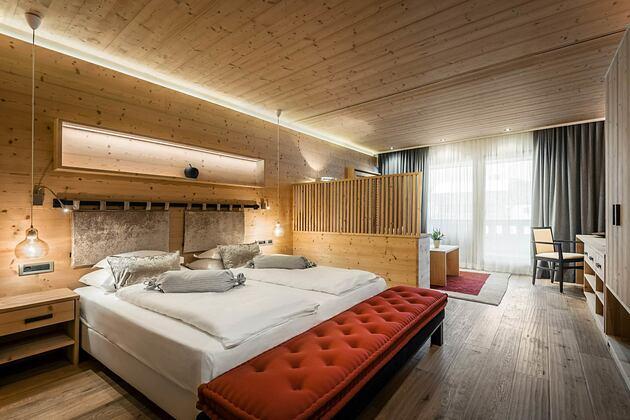 Large bedroom at Hotel La Majun Italy